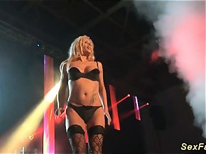 German huge-titted milf on public stage