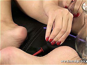 buxomy Elena Rae pisses through her stockings