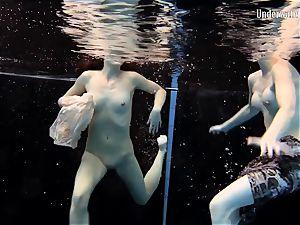 2 ladies swim and get bare splendid