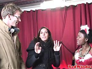 dark-hued amsterdam prostitute handles white fellow