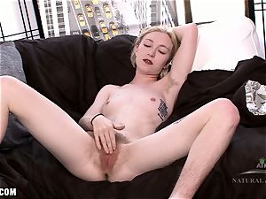 Ivy fondles her fur covered turgid clitoris