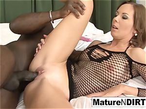 black-haired mummy masturbates before taking a big black cock